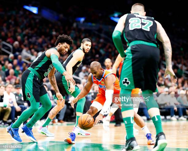 Chris Paul of the Oklahoma City Thunder reacts to a lose ball during the first quarter of the game against the Boston Celtics at TD Garden on March...