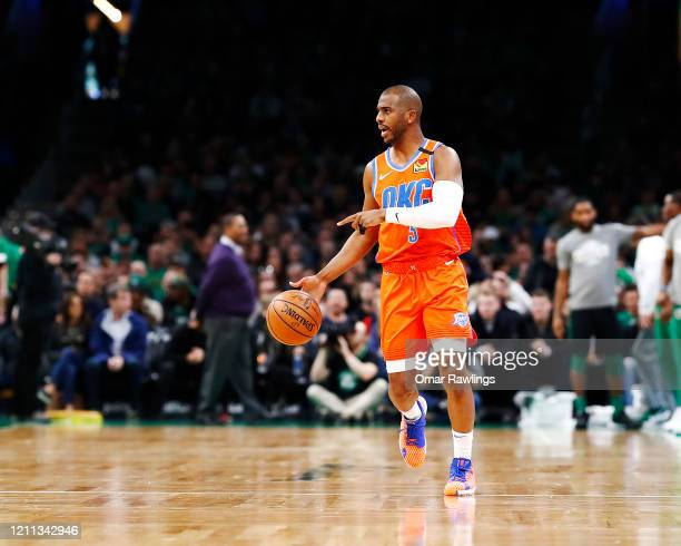 Chris Paul of the Oklahoma City Thunder reacts while bringing the ball up court during the first quarter of the game against the Boston Celtics at TD...