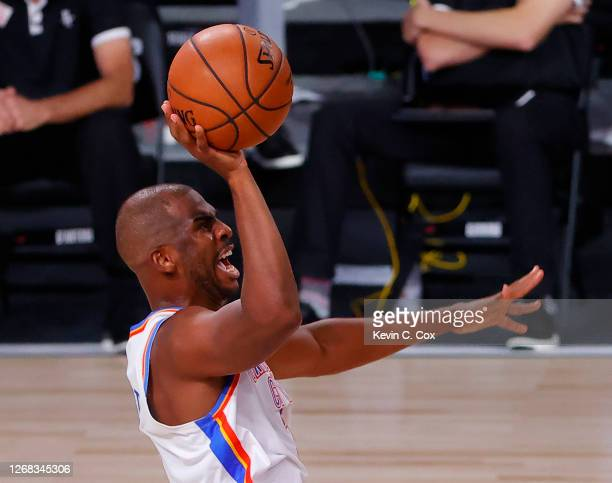 Chris Paul of the Oklahoma City Thunder shoots against the Houston Rockets during the third quarter in Game Four of the Western Conference First...