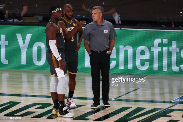 Chris Paul of the Oklahoma City Thunder talks with head coach Billy Donovan and guard Luguentz Dort during the third quarter against the Denver...
