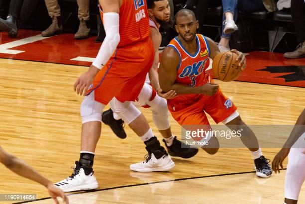 Chris Paul of the Oklahoma City Thunder tries to move during the Toronto Raptors vs Oklahoma City Thunder NBA regular season game at Scotiabank Arena...