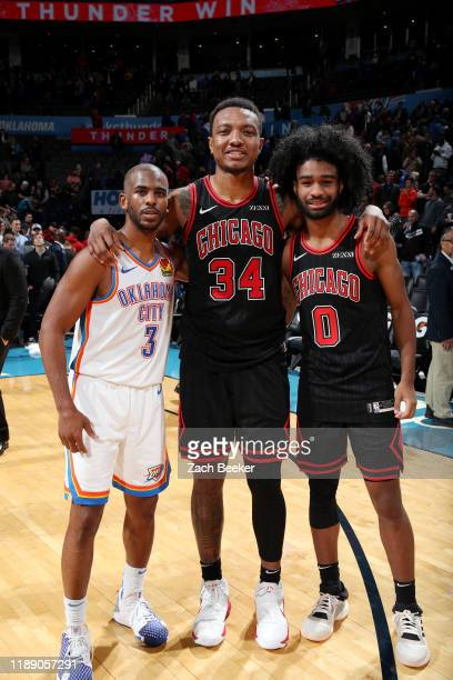Chris Paul of the Oklahoma City Thunder Wendell Carter Jr #34 of the Chicago Bulls and Coby White of the Chicago Bulls together after a game on...