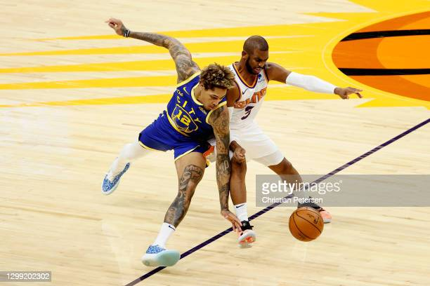 Chris Paul of the Phoenix Suns and Kelly Oubre Jr. #12 of the Golden State Warriors battle for a loose ball during the first half of the NBA game at...
