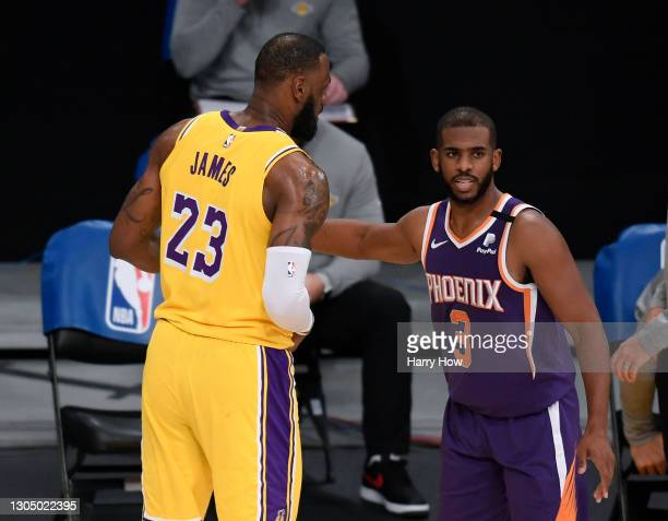 Chris Paul of the Phoenix Suns and LeBron James of the Los Angeles Lakers shake hands after a 114-104 Suns win at Staples Center on March 02, 2021 in...