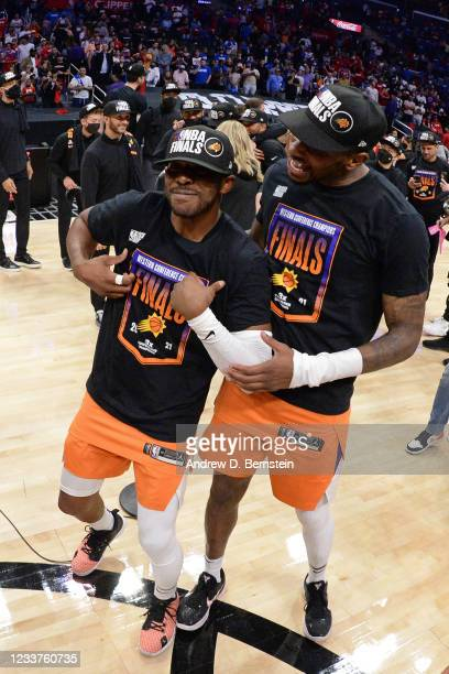 Chris Paul of the Phoenix Suns and Torrey Craig of the Phoenix Suns celebrate after the game against the LA Clippers during Game 6 of the Western...