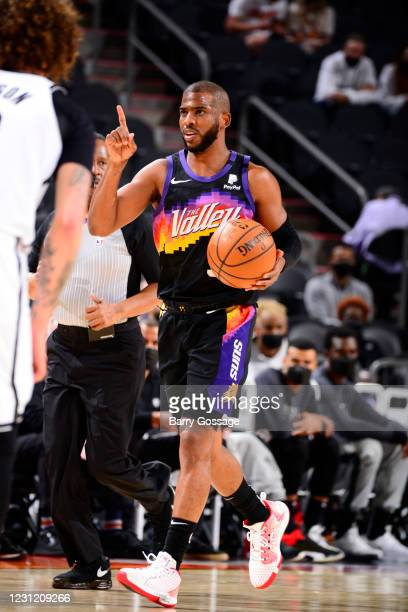Chris Paul of the Phoenix Suns dribbles during the game against the Brooklyn Nets on February 16, 2021 at Talking Stick Resort Arena in Phoenix,...