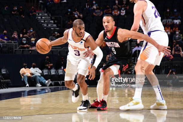 Chris Paul of the Phoenix Suns dribbles the ball during the game against the Houston Rockets on April 12, 2021 at Phoenix Suns Arena in Phoenix,...