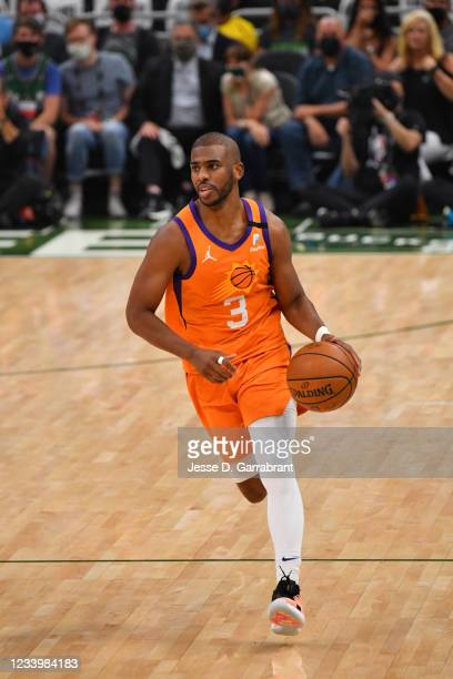 Chris Paul of the Phoenix Suns handles the ball against the Milwaukee Bucks during Game Four of the 2021 NBA Finals on July 14, 2021 at Fiserv Forum...