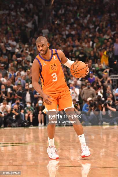 Chris Paul of the Phoenix Suns handles the ball against the Milwaukee Bucks during Game Six of the 2021 NBA Finals on July 20, 2021 at Fiserv Forum...