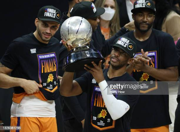 Chris Paul of the Phoenix Suns holds the Western Conference Championship trophy after the Suns defeated the LA Clippers in Game Six of the Western...