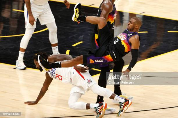 Chris Paul of the Phoenix Suns is fouled by Patrick Beverley of the LA Clippers during the second half in Game Five of the Western Conference Finals...