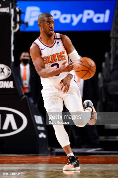 Chris Paul of the Phoenix Suns passes the ball during the game against the Memphis Grizzlies on March 15, 2021 at Talking Stick Resort Arena in...