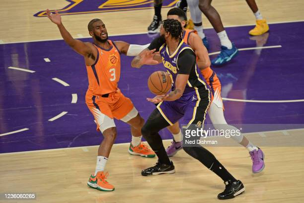 Chris Paul of the Phoenix Suns plays defense on Anthony Davis of the Los Angeles Lakers on October 22, 2021 at STAPLES Center in Los Angeles,...