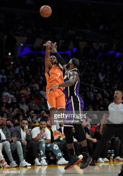 Chris Paul of the Phoenix Suns shoots a three pint basket over LeBron James of the Los Angeles Lakers during the second half of the game at Staples...