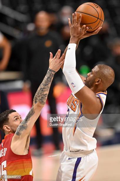 Chris Paul of the Phoenix Suns shoots over Austin Rivers of the Denver Nuggets in Game Four of the Western Conference second-round playoff series at...