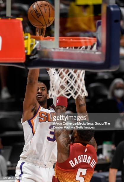 Chris Paul of the Phoenix Suns shoots over Will Barton of the Denver Nuggets during the second quarter at Ball Arena on Sunday, June 13, 2021. The...