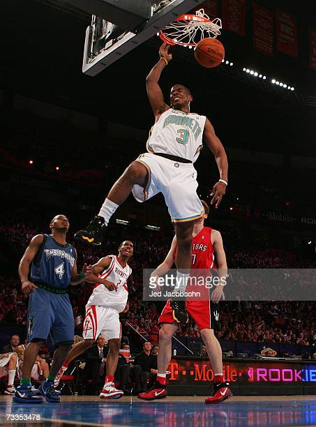 Chris Paul of the Sophomore Team dunks over Randy Foye of the Rookie Team during the TMobile Rookie Challenge at NBA AllStar Weekend on February 16...