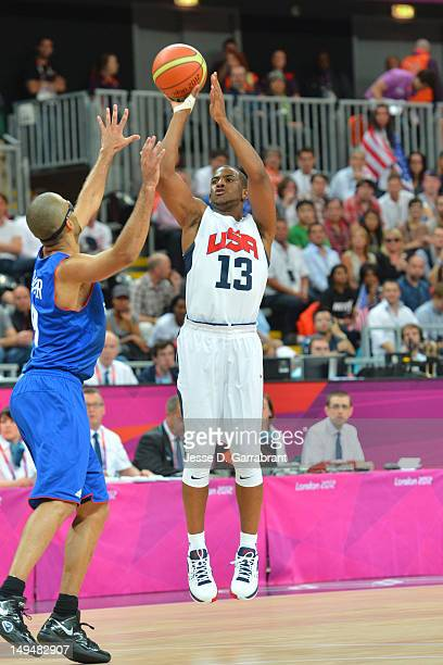 Chris Paul of the USA Mens Senior National team shoots against Tony Parker of France at the Olympic Park Basketball Arena during the London Olympic...