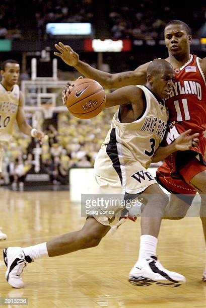 Chris Paul of the Wake Forest Demon Deacons drives against John Gilchrist of the University of Maryland Terrapins on January 29 2004 at the Lawrence...