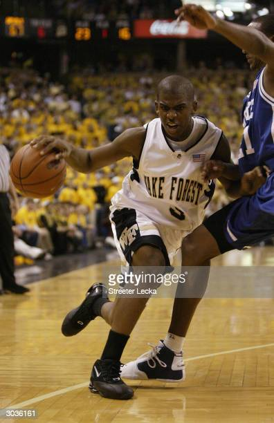 Chris Paul of the Wake Forest Demon Deacons drives on Chris Duhon of the Duke Blue Devils during the game on February 18, 2004 at the Lawrence Joel...