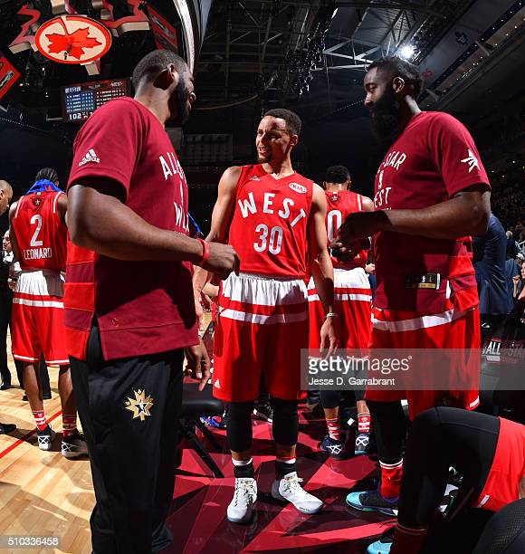Chris Paul of the Western Conference AllStars Stephen Curry and James Harden have a conversation during the NBA AllStar Game as part of the 2016 NBA...