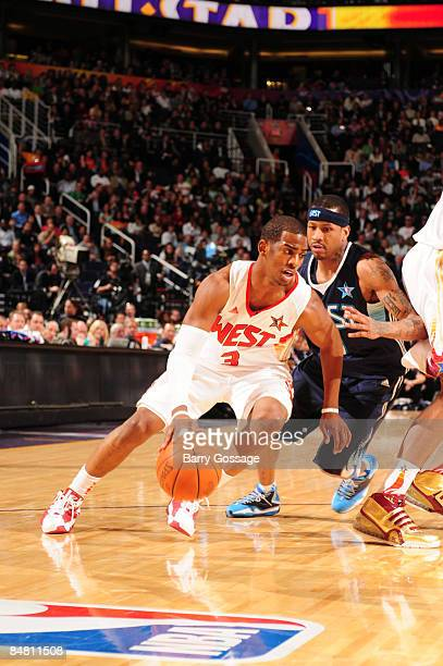 Chris Paul of the Western Conference dribbles against Allen Iverson of the Eastern Conference during the 58th NBA AllStar Game part of 2009 NBA...