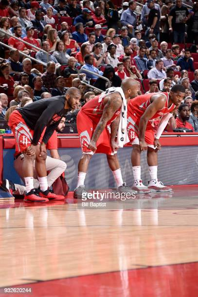 Chris Paul PJ Tucker and Joe Johnson of the Houston Rockets look on during the game against the LA Clippers on March 15 2018 at the Toyota Center in...