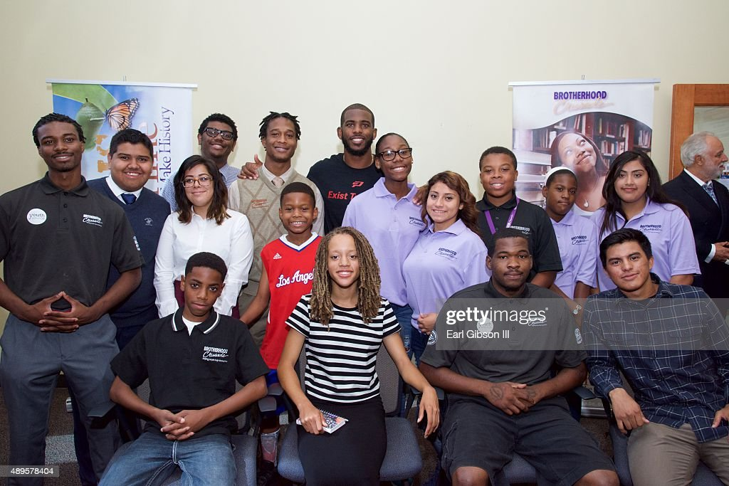 Chris Paul poses with the student body of the Brotherhood Crusade at the Chris Paul Family Foundation's 'Exist to Assist' Community Program Launch at Brotherhood Crusade on September 22, 2015 in Los Angeles, California.