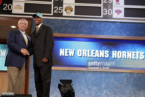 Chris Paul shakes hands with NBA Commissioner David Stern after being selected fourth overall by the New Orleans Hornets during the 2005 NBA Draft on...