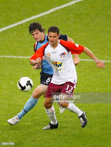 Chris Payne of Sydney FC contests the ball with Chris Grossman of the Roar during the National Youth League round 10 match between Sydney FC and the...