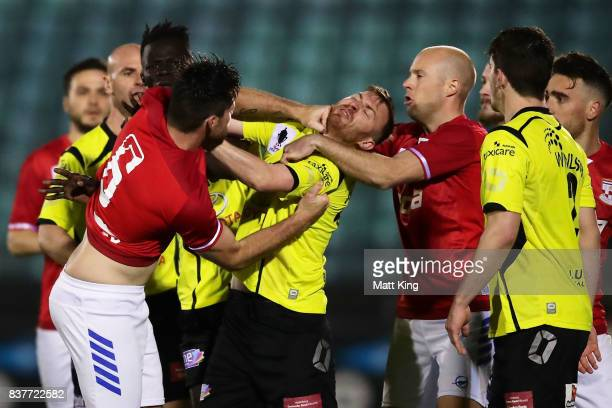Chris Payne of Sydney United 58 FC scuffles with Jack Petrie of Heidleberg United during the FFA Cup round of 16 match between Sydney United 58 FC...