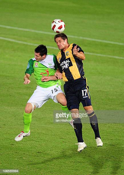Chris Payne of the Fury contests the ball with Chris Doig of the Mariners during the round 13 ALeague match between the North Queensland Fury and the...