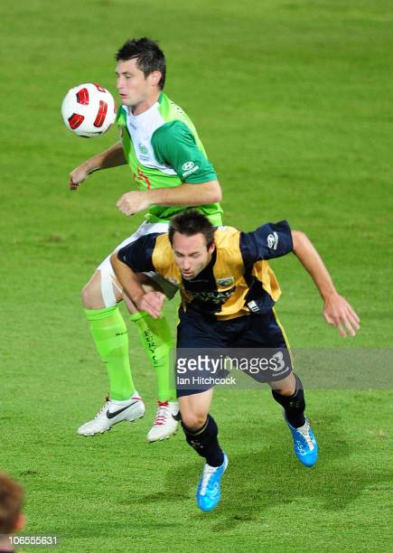 Chris Payne of the Fury contests the ball with Josh Rose of the Mariners during the round 13 ALeague match between the North Queensland Fury and the...