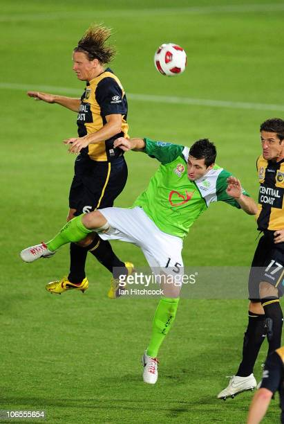 Chris Payne of the Fury contests the ball with Patrick Zwaanswijk of the Mariners during the round 13 ALeague match between the North Queensland Fury...