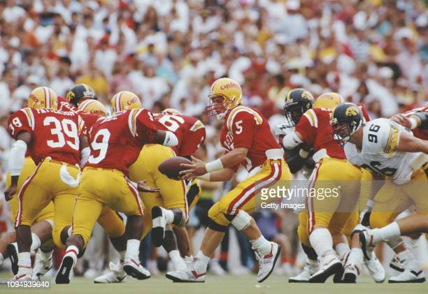 Chris Pedersen Quarterback for the Iowa State Cyclones hands the ball off to Running Back Lamont Hill during the NCAA Big Eight Conference college...