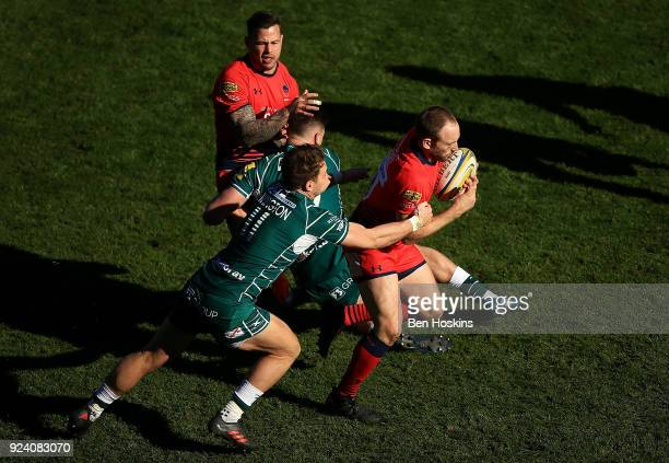 Chris Pennell of Worcester is tackled by Alex Lewington of London Irish during the Aviva Premiership match between London Irish and Worcester...