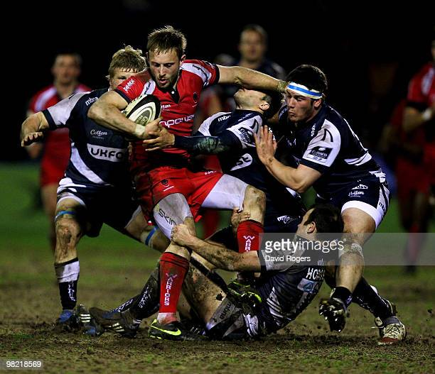 Chris Pennell of Worcester is tackled by the Sale defence during the Guinness Premiership match between Sale Sharks and Worcester Warriors at Edgeley...