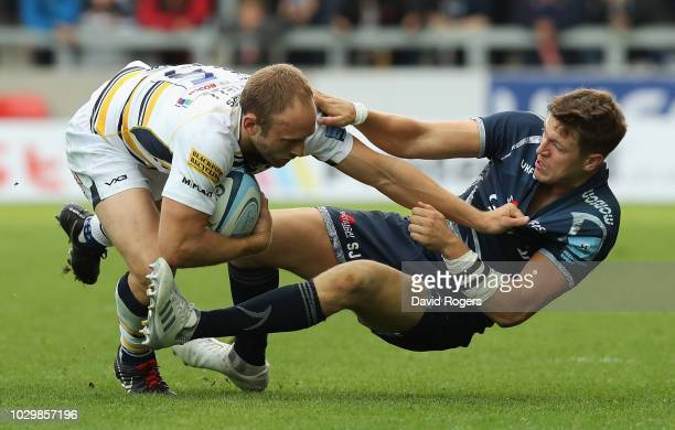 Chris Pennell of Worcester Warriors is tackled by Sam James during the Gallagher Premiership Rugby match between Sale Sharks and Worcester Warriors...