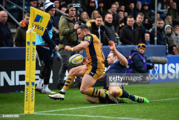 Chris Pennell of Worcester Warriors tackles Alby Mathewson of Bristol Rugby during the Aviva Premiership match between Worcester Warriors and Bristol...
