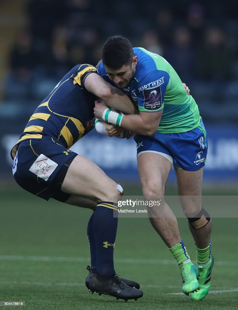 Chris Pennell of Worcester Warriors tackles Tiernan O'Halloran of Connacht Rugby during the European Rugby Challenge Cup match between Worcester Warriors and Connacht Rugby on January 13, 2018 in Worcester, United Kingdom.