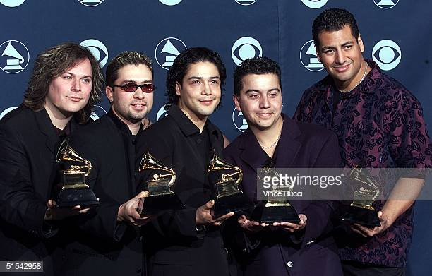 """Chris Perez and his band hold the Grammy for Best Latin Rock Alternative Performance for """"Resurrection"""" at the 42nd Annual Grammy Awards 23 February..."""