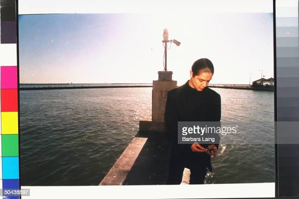 Chris Perez husband of late tejano singer Selena who was shot by her former fan club pres Yolanda Saldivar standing on dock nr water