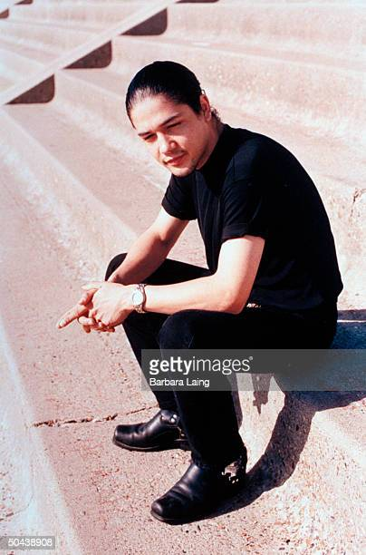 Chris Perez husband of slain tejano singer Selena posing outside on concrete steps