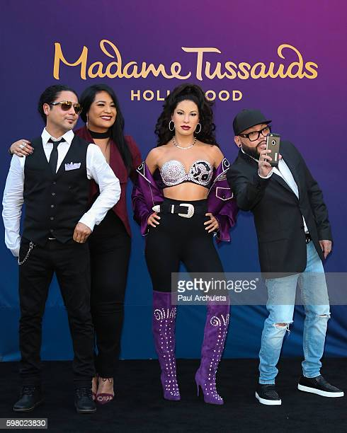 Chris Perez, Suzette Quintanilla, Selena Quintanilla and A.B. Quintanilla attend the unveiling of the Selena Quintanilla wax figure at The Madame...