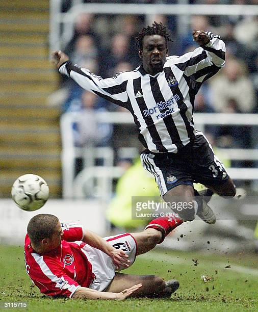 Chris Perry of Charlton battles with Olivier Bernard of Newcastle during the FA Barclaycard Premiership match between Newcastle United and Charlton...