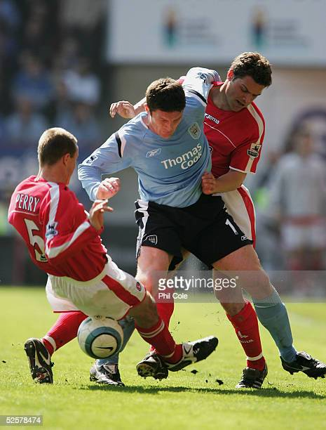 Chris Perry of Charlton slides in on Jon Macken of Manchester City as Luke Young of Charlton challenges from behind during the Barclays Premiership...
