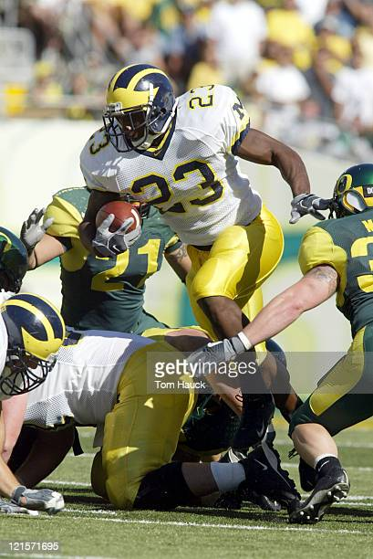 Chris Perry of the Michigan Wolverines runs with the ball against the Oregon defense at Autzen Stadium in Eugene Oregon Oregon defeated Michigan 3127