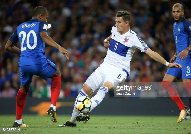 Chris Philipps of Luxembourg Kylian Mbappe of France during the FIFA 2018 World Cup Qualifier between France and Luxembourg at the Stadium on...