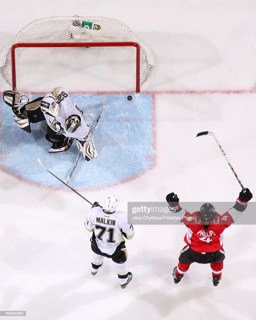 Chris Phillips #4 of the Ottawa Senators celebrates a late third period game tying goal scored by Daniel Alfredsson #11 (not shown) against Tomas Vokoun #92 of the Pittsburgh Penguins as Evgeni Malkin #71 of the Pittsburgh Penguins looks on, in Game Three of the Eastern Conference Semifinals during the 2013 NHL Stanley Cup Playoffs, at Scotiabank Place, on May 19, 2013 in Ottawa, Ontario, Canada.