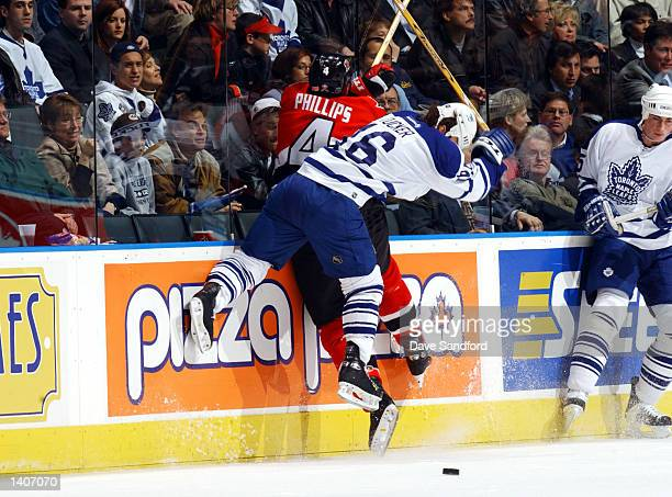 Chris Phillips of the Ottawa Senators is checked by Darcy Tucker of the Toronto Maple Leafs in game one of the Eastern Conference Semifinal series...